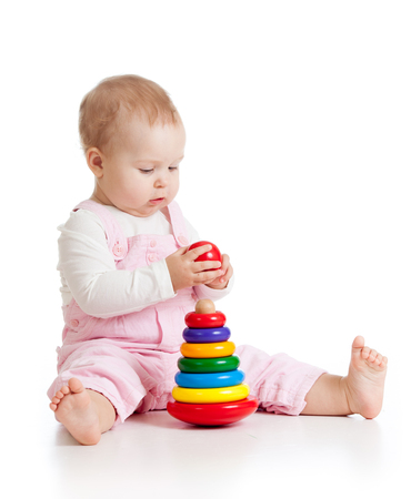 Nursery baby playing with pyramid toy