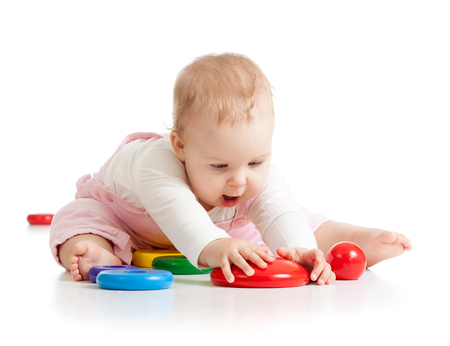 Funny baby playing with toys isolated ober white background