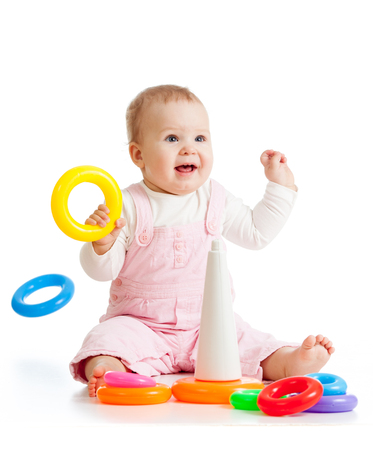 Cheerful baby playing with pyramid toy Banco de Imagens