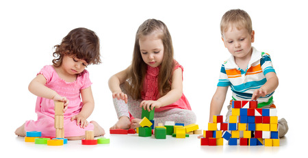 kids toddlers playing wooden blocks toy isolated on white