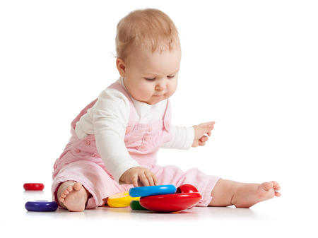 Infant baby plays with educational toy Banco de Imagens