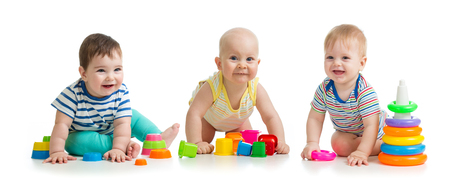 Nursery babies playing with toys isolated on white background Banco de Imagens