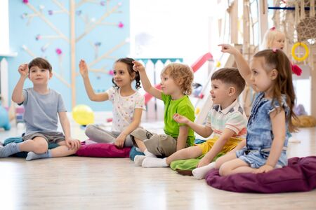 Preschool children on speech therapy lesson in kindergarten