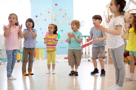 Kids group have fun and play at kindergarden