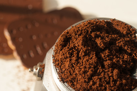 chocolate cookie and spilled coffee beans Stock Photo