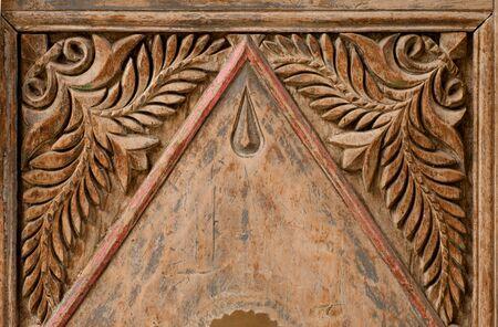 marqueteria: ancient carving on the door in Turkey, Goreme Foto de archivo