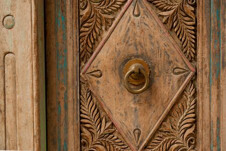 marqueteria: ancient carving on the door in Turkey, Goreme Foto de archivo