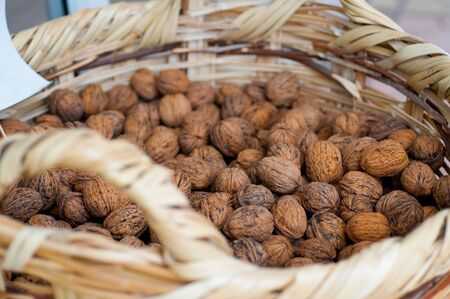 nutshells: Walnuts in a wicker basket close-up