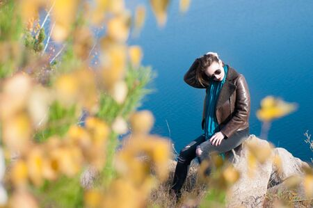 blonde girl with short haircut on nature background in autumn, Chelyabinsk Region, Russia