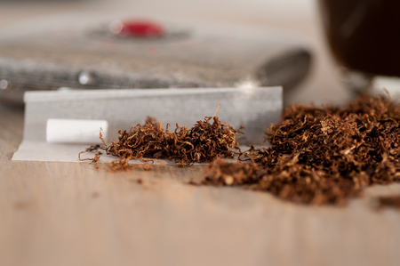 Smoking tobacco and roll-up close-up