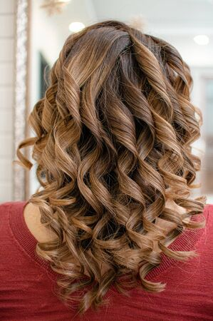Long brown hair curled the process of creating a hollywood hairstyle close-up