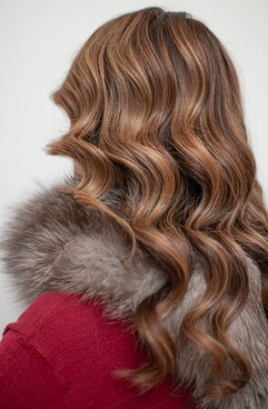 Female hairstyle on long brown hair hollywood wave back view