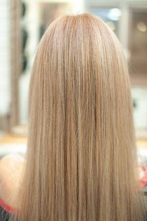 Blonde hair from the back in a beauty salon