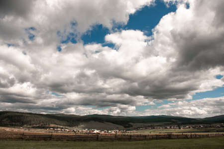 Beautiful summer landscape view with cloudy sky and village 版權商用圖片