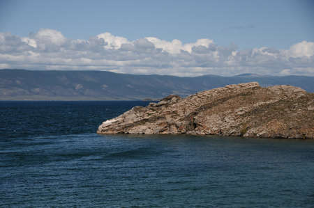 Lake Baikal with blue water and rocky shore 版權商用圖片