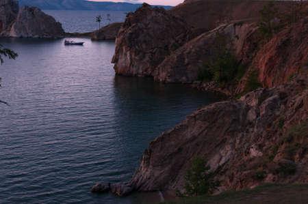 Cape Burkhan or Shamanka Rock in Russia, Olkhon island on Lake Baikal in summer in the evening