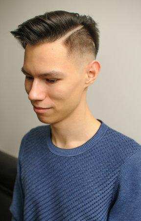 Short haircut on a young man with dark hair 版權商用圖片