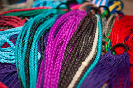 Colored braids on an elastic band for hair, accessory close-up Reklamní fotografie