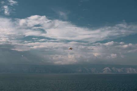 Lake Baikal coastline on a summer cloudy day