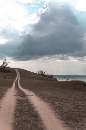 Dirt road along the shore of Lake Baikal in summer