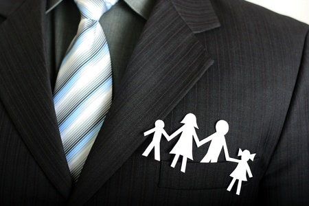 Paper family in a businessman photo