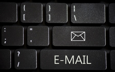 Black laptop keyboard with white e-mail buttons Stock Photo - 12999635