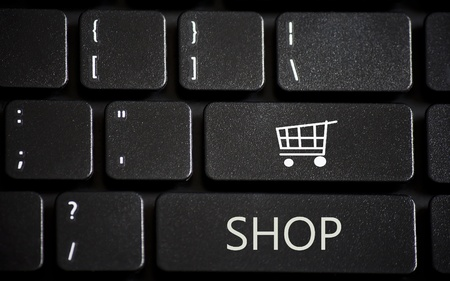 Laptop keyboard with online shopping buttons Stock Photo