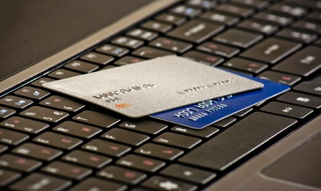 Laptop keyboard with credit cards, selective focus Stock Photo
