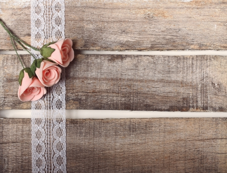 Pink roses on wooden background - greeting card or invitation Stock Photo - 19088166