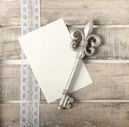 Silver key on wooden diary greeting card photo