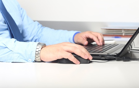Businessman with computer keyboard in office environment photo