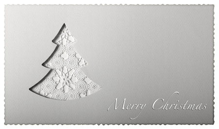 Christmas card tree cut on paper with greeting text