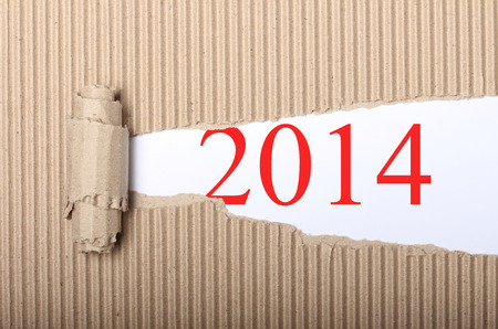 White paper with Happy New Year 2014 text and torn cardbox
