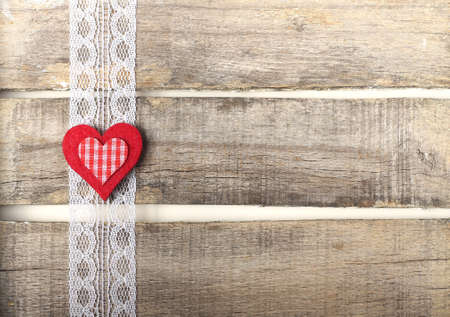 Red heart on old wooden background with lace Archivio Fotografico