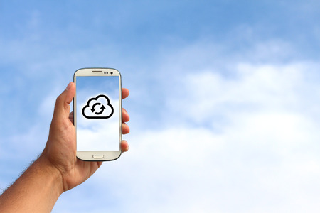 Cloud icon on a mobile phone on sky background