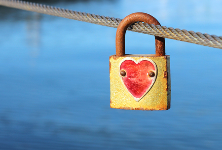 Padlock with red heart on metal string