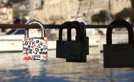 Padlock with love text on metal string