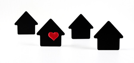 Black house symbols on white background with red heart Stock Photo