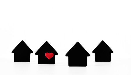Black house symbols on white background with red heart Archivio Fotografico