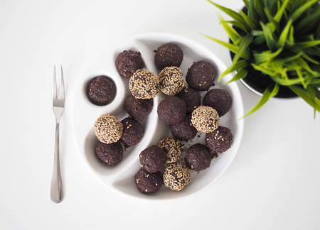 Raw vegan sweet balls with chocolate and sesame Archivio Fotografico