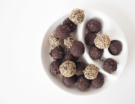 Raw vegan sweet balls with chocolate and sesame Archivio Fotografico