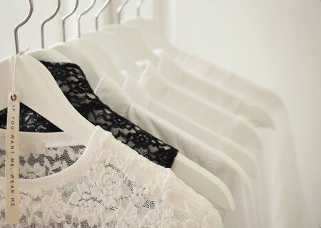 White female clothes collection on wooden hangers Archivio Fotografico - 144095873