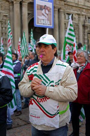 demonstrator: MILAN, ITALY, Piazza della Scala, 21 April 2012. Meeting of Italian Trade Unions Lombardy. Speaker - Giga Petteni