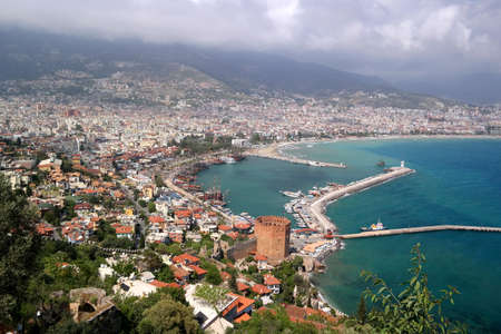 seljuk: View of the city of Alanya, , red tower, dock, ships