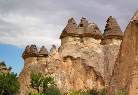 terrain: Cappadocia, stone pillars created by nature through erosion. Bottom tuff top - basalt. Stock Photo