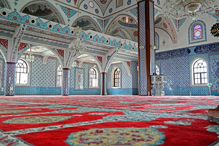 prayer rug: The interior of the majestic mosque at Manavgat in Turkey. Red carpet, blue, turquoise color of the walls.
