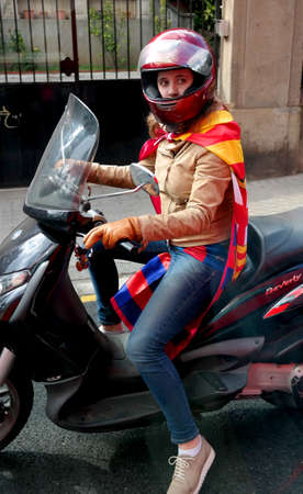 Barcelona, Spain - May 17, 2014: FC Barcelona fans on motor scooter. a girl flag team