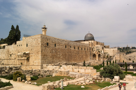 protection of the bible: Jerusalem, Israel - May 8, 2013: Dome of Al-Musalla Al-Qibli Al-Aqsa - the largest mosque in the city, Archaeological Gardens of Umayyad Palaces and Mount of Olives. Tourists sightseeing.