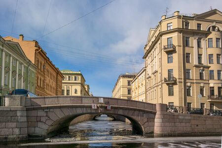 piter: St. Petersburg, Winter Canal, the second winter bridge. Sunny spring day on the water ice. Stock Photo