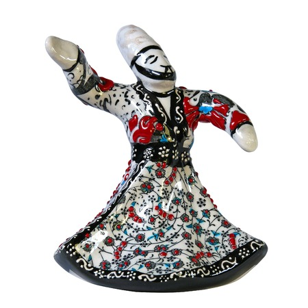 liturgy: Saint-Petersburg, Russia - April 26, 2016: Ceramic figurine of a dancing dervish. The figure clearly made up. Isolated object.  Side view.